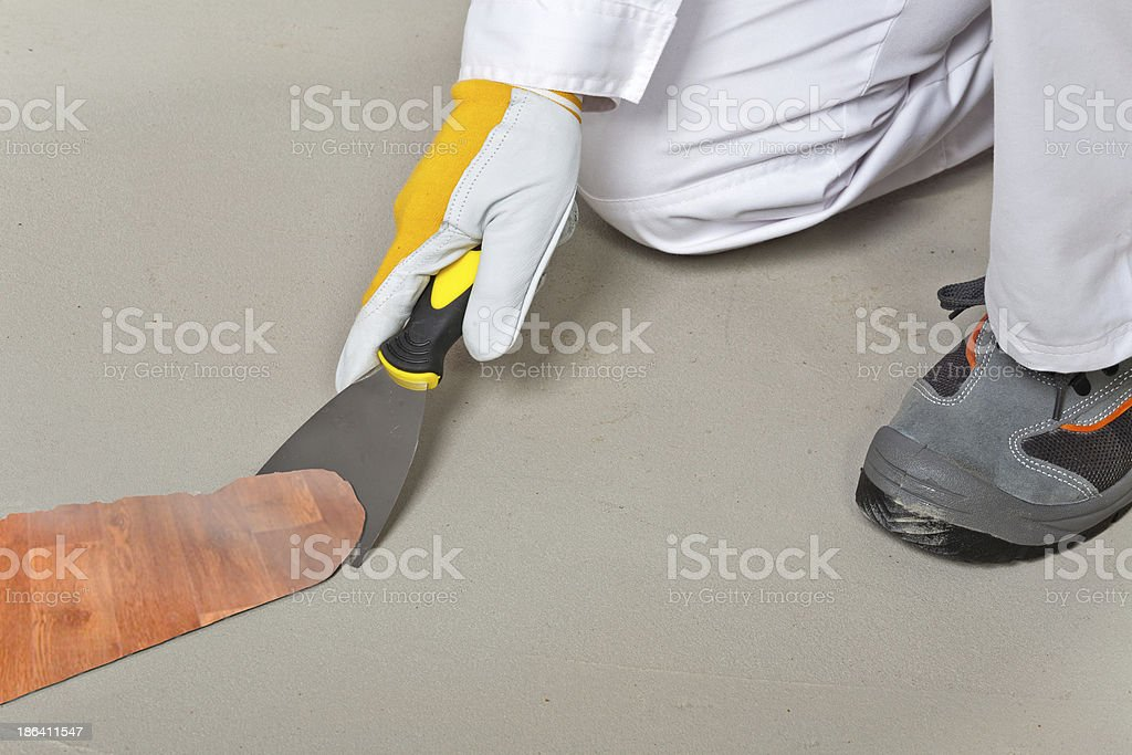 worker remove old carpet from floor with trowel royalty-free stock photo