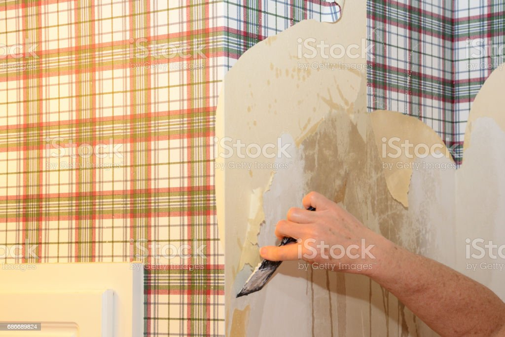 Worker removing wall paper stock photo