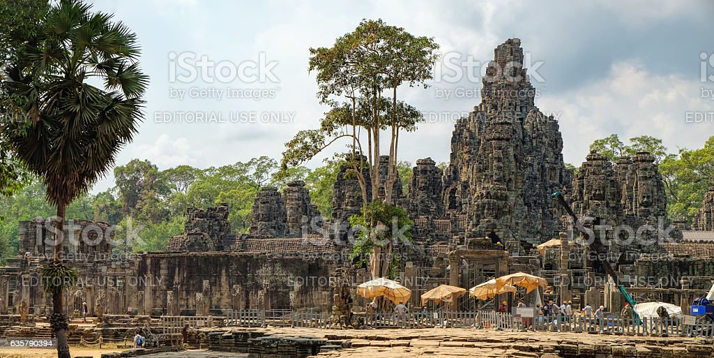 Worker renovate Bayon temple, Cambodia stock photo