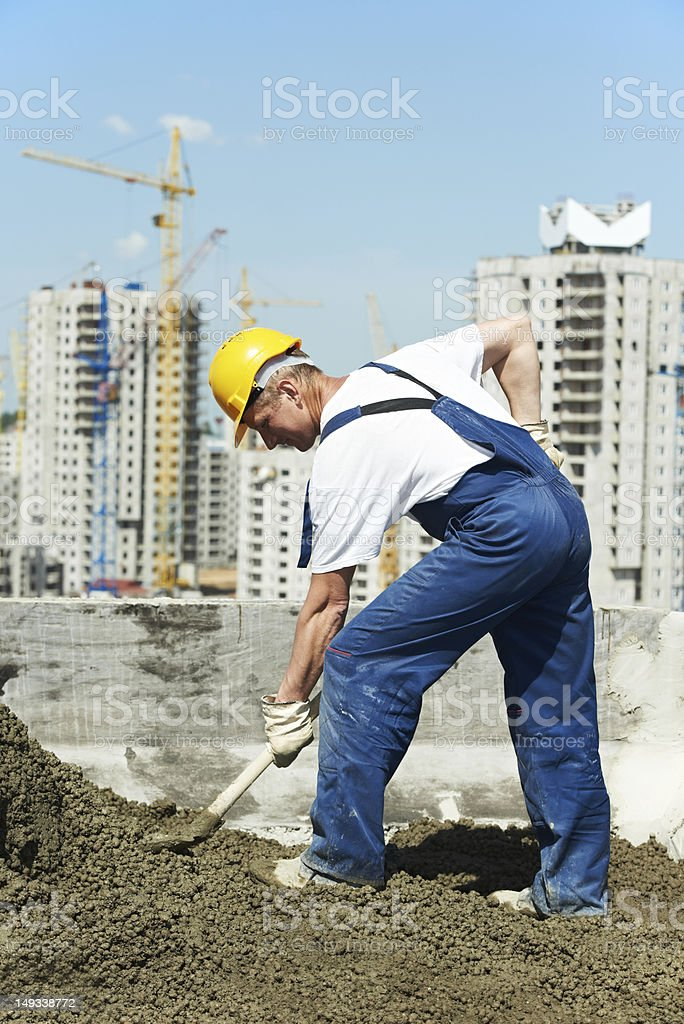 worker roofer with shovel stock photo