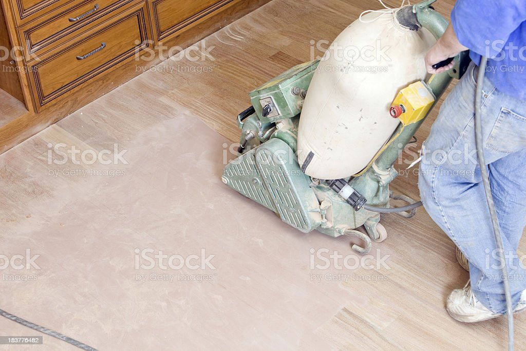 Worker Sanding a New Hardwood Floor royalty-free stock photo