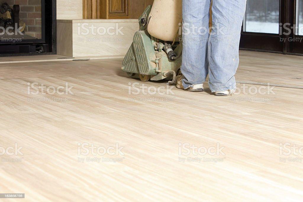 Worker Sanding a New Hardwood Floor stock photo