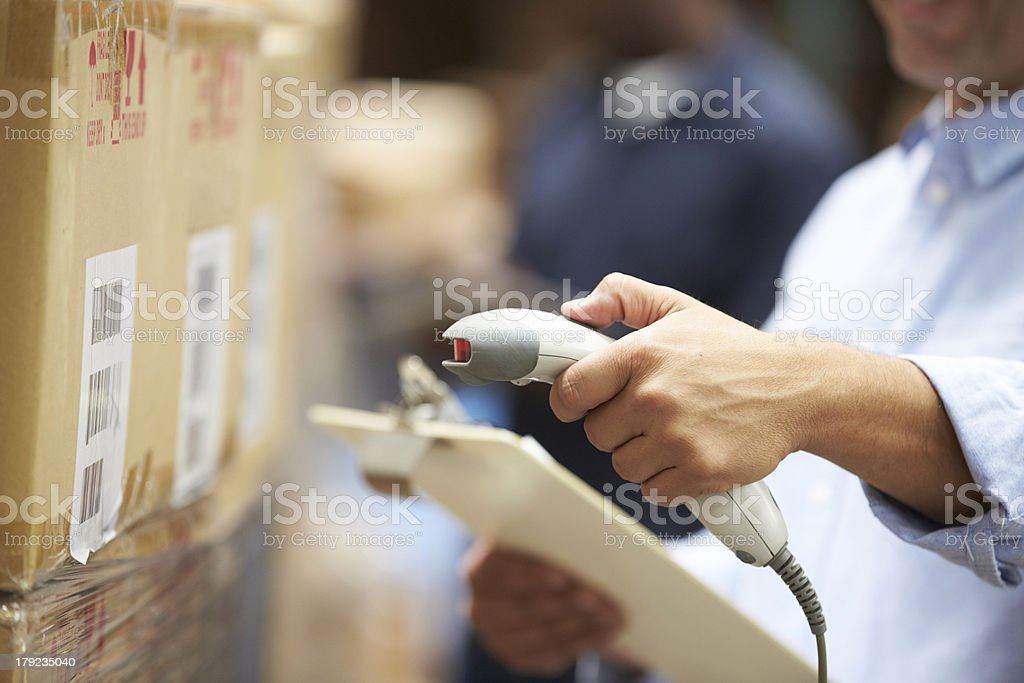 Worker Scanning Package In Warehouse royalty-free stock photo