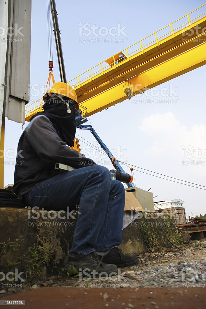 worker sitting foreground royalty-free stock photo