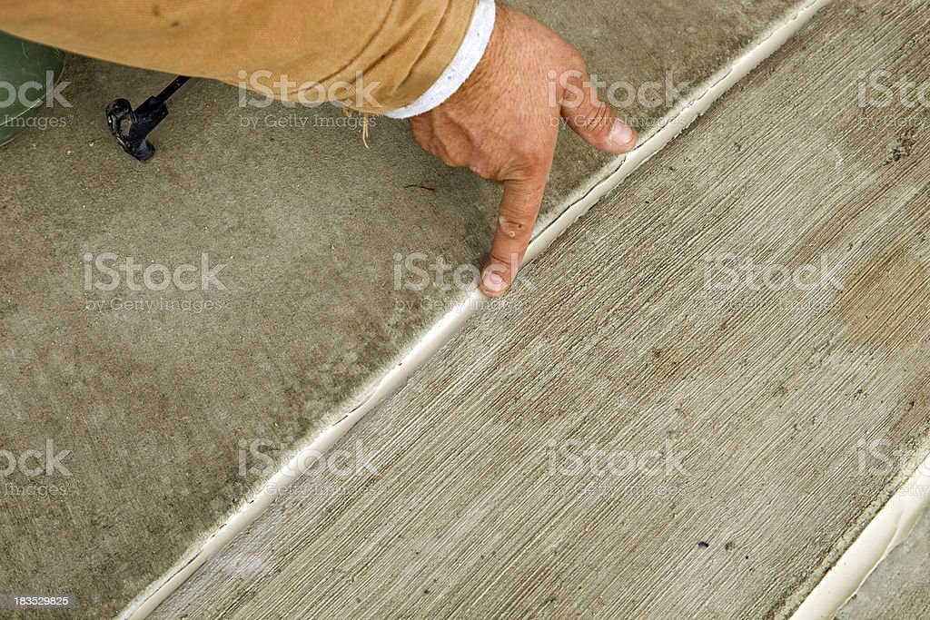 Worker Spreading Concrete Caulk with Finger stock photo
