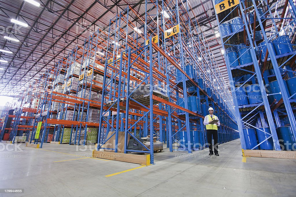 Worker standing in warehouse stock photo