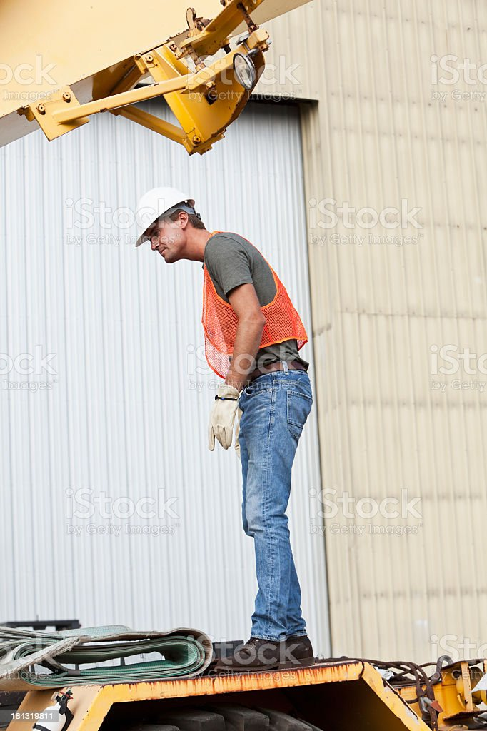 Worker standing on crane stock photo