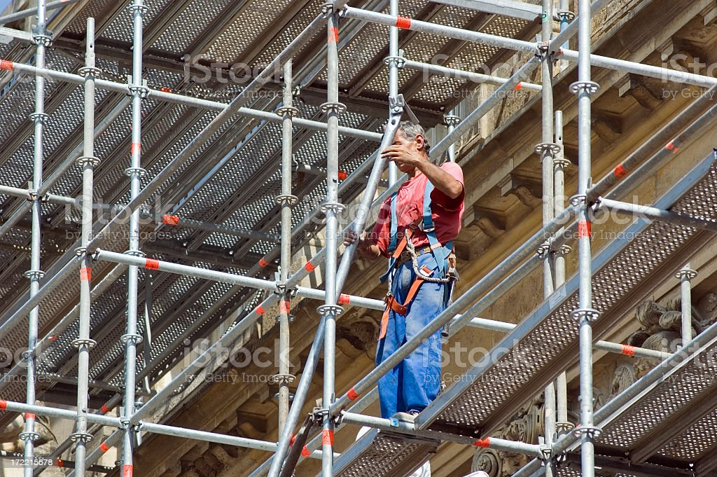 Worker standing on scaffolding stock photo