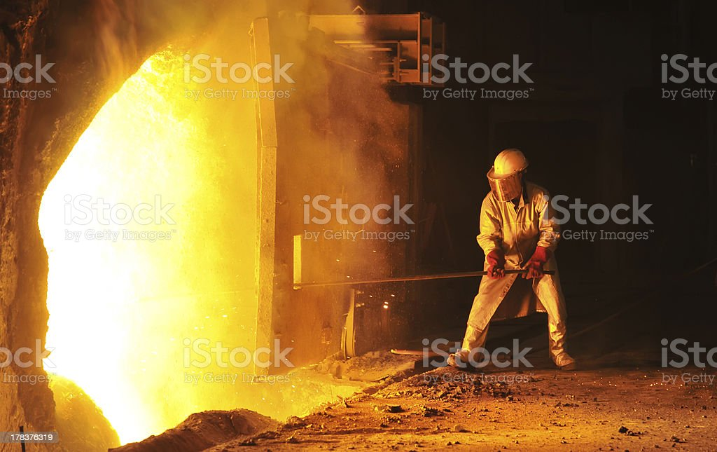 worker takes a sample at steel company stock photo
