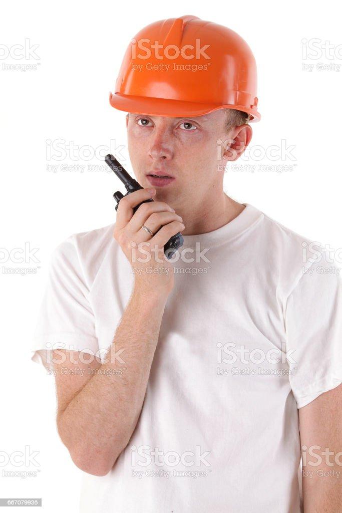 worker talking on portable UHF radio transceiver stock photo