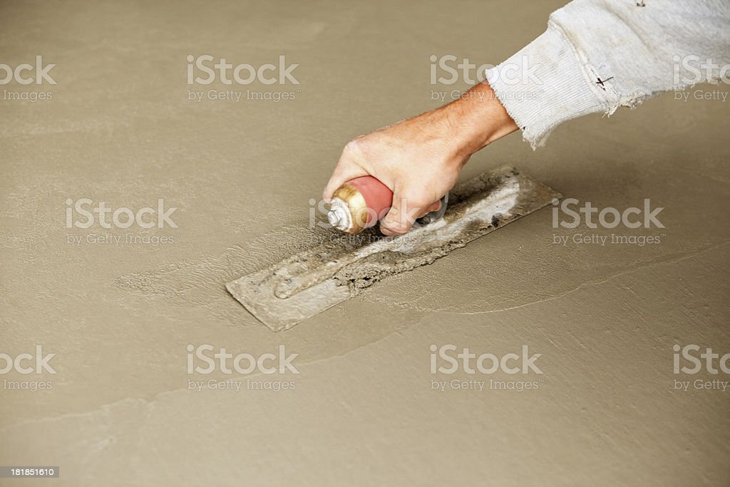 Worker Troweling Wet Concrete royalty-free stock photo