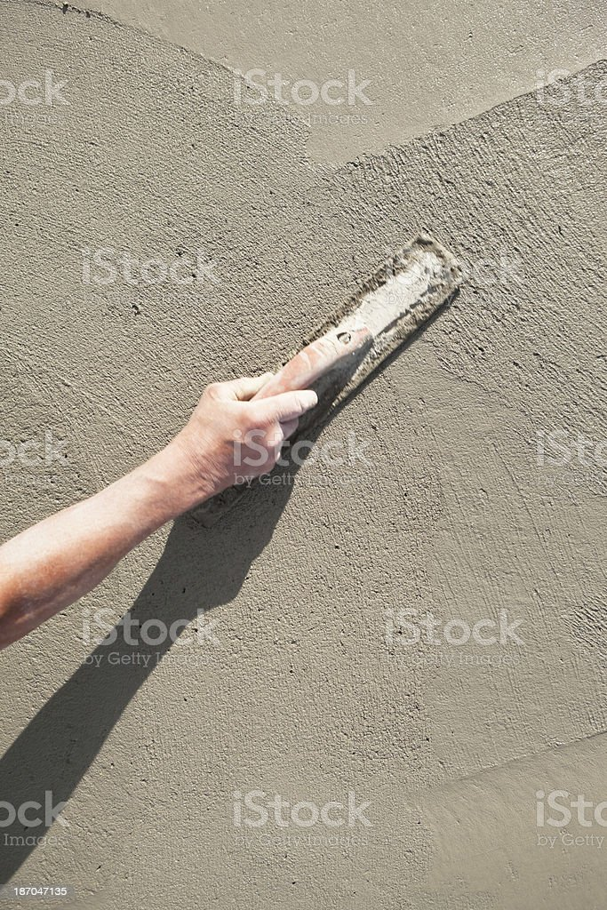 Worker Troweling Wet Concrete stock photo