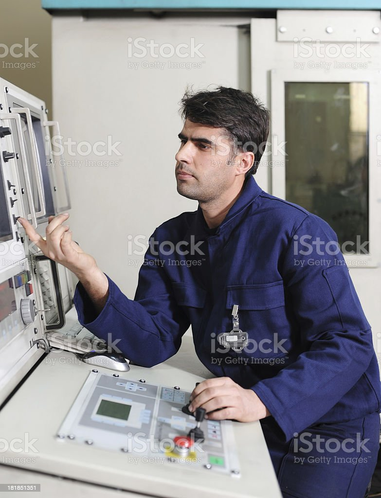 Worker turning on monitor royalty-free stock photo