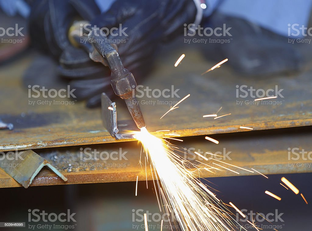 worker use acetylene torch to cutting metal stock photo