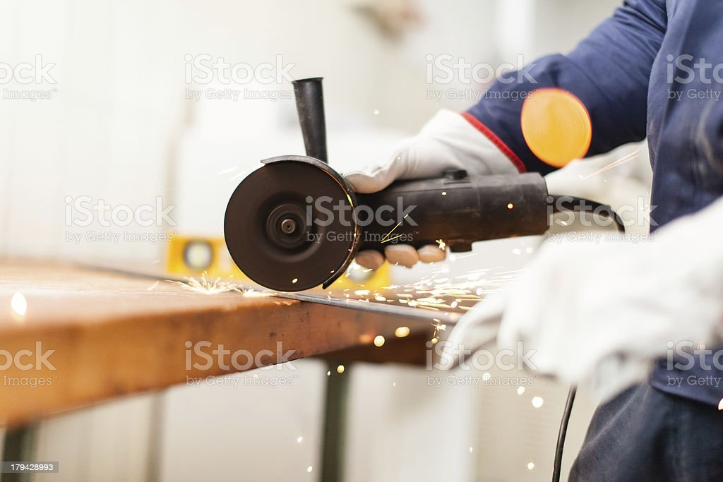 Worker using a grinder royalty-free stock photo