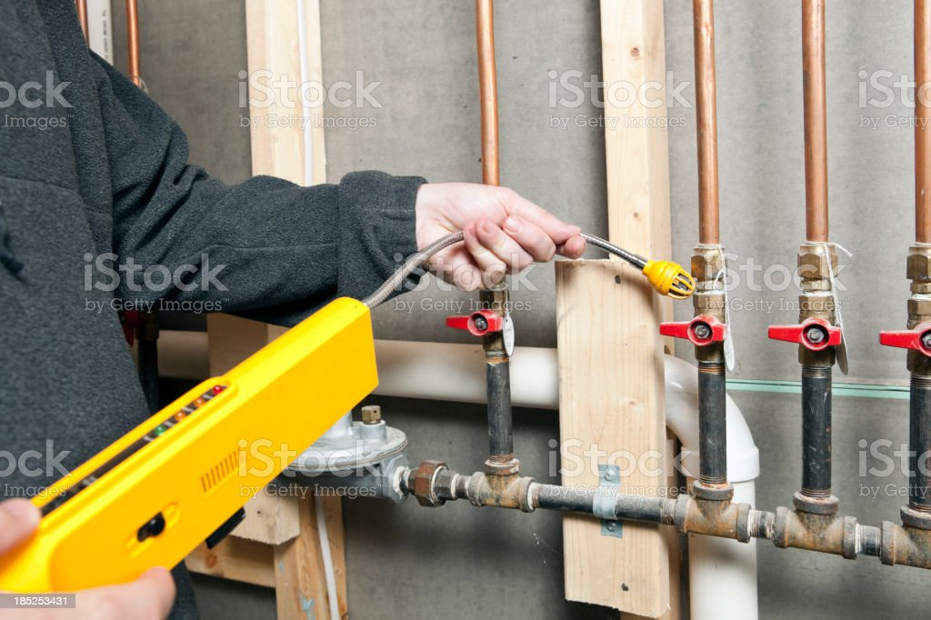 Worker Using a Leak Detector near House Gas Lines stock photo