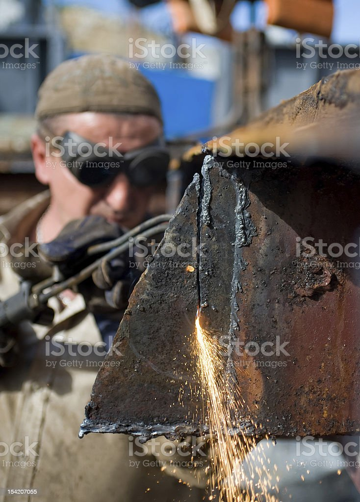 Worker using a propane torch royalty-free stock photo