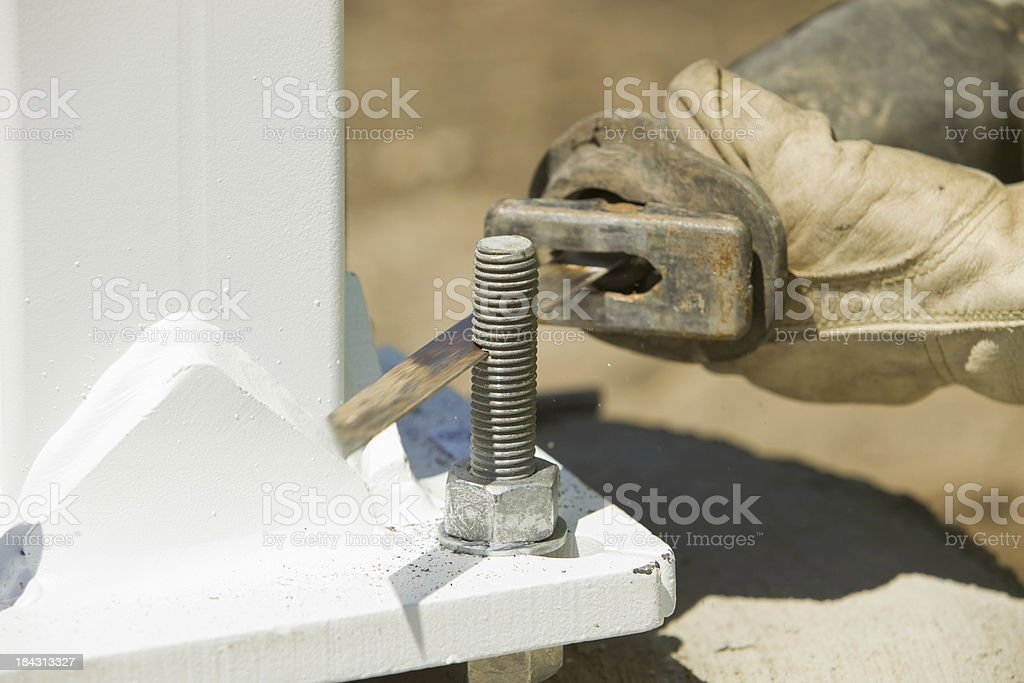 Worker Using a Reciprocating Saw to Cut Bolt stock photo