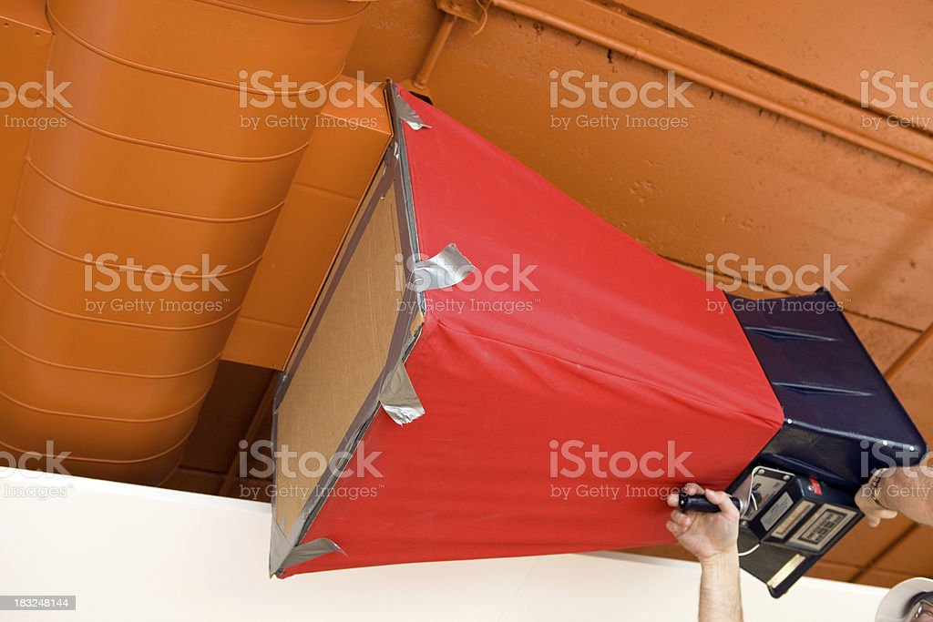 Worker using an Air Capture Hood Flow Balancer royalty-free stock photo
