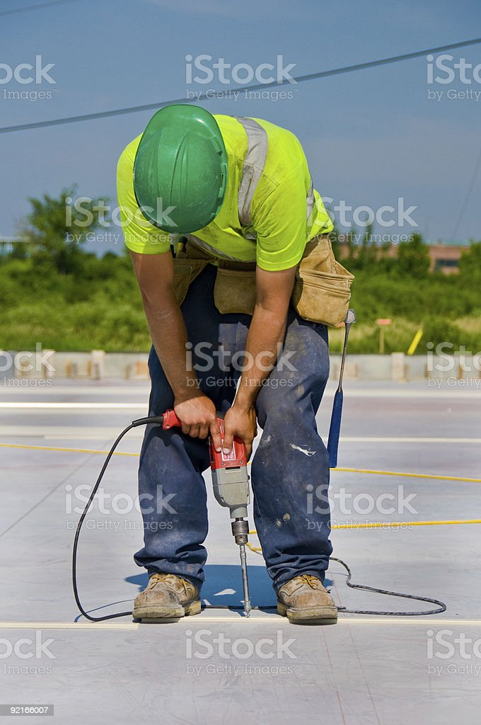 Worker Using Cement Drill royalty-free stock photo