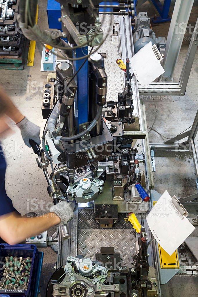 Worker using machine stock photo
