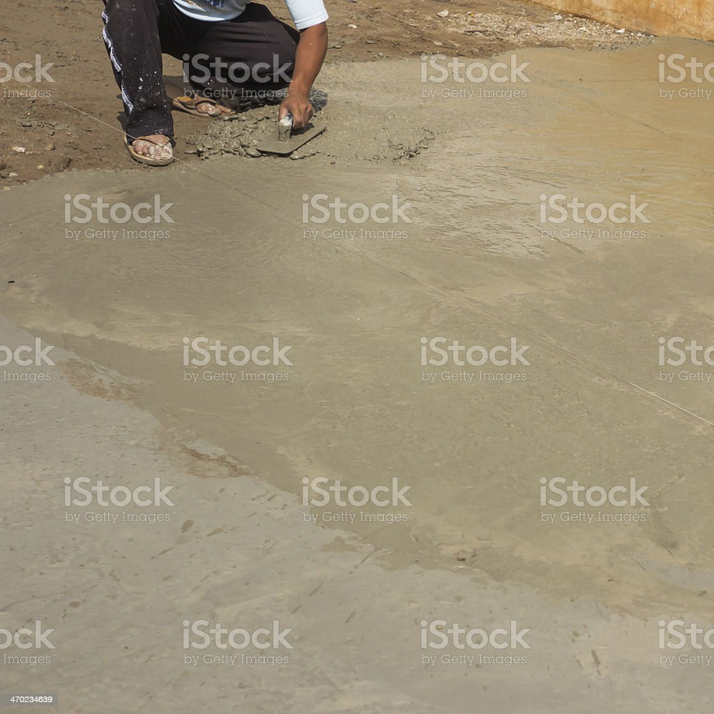Worker Using Trowel to Smooth Concrete royalty-free stock photo