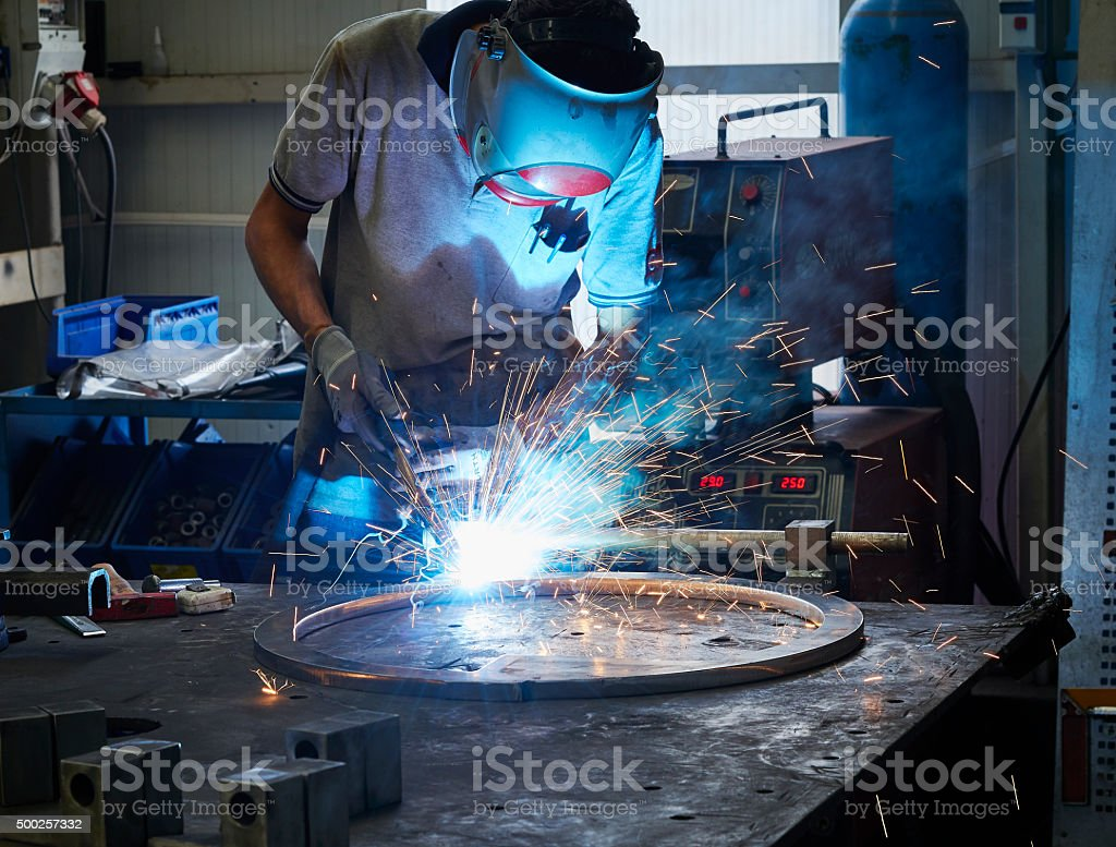 Worker using welder stock photo
