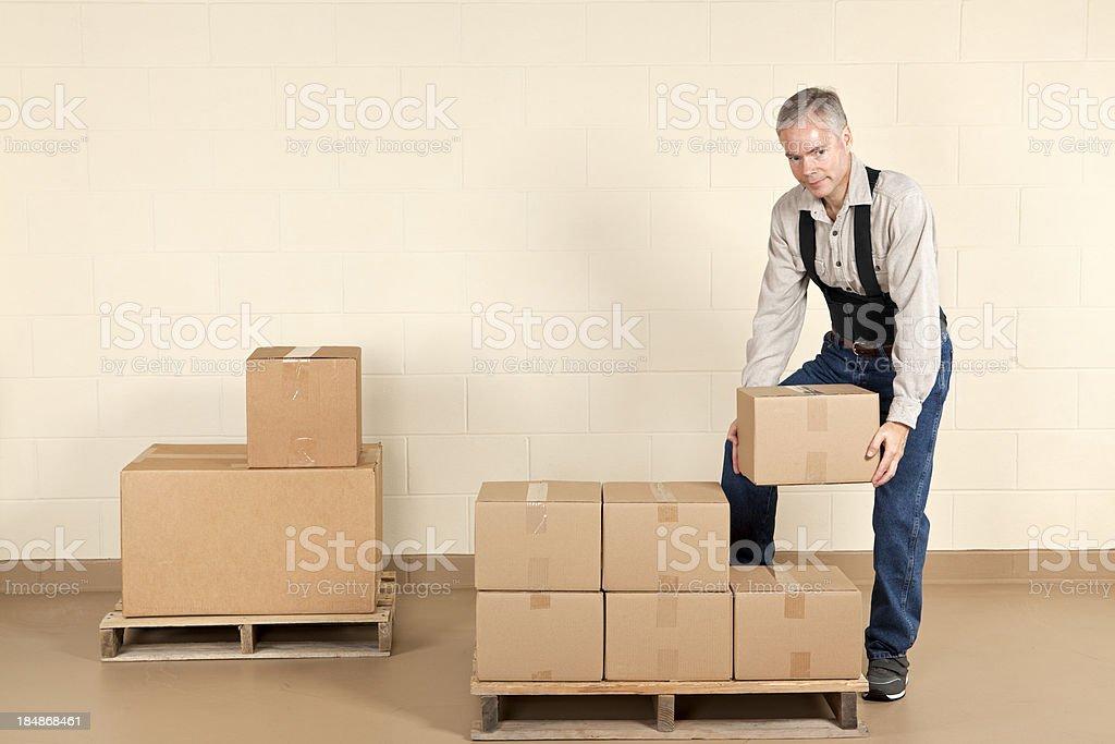 Worker Wearing a Back Brace royalty-free stock photo