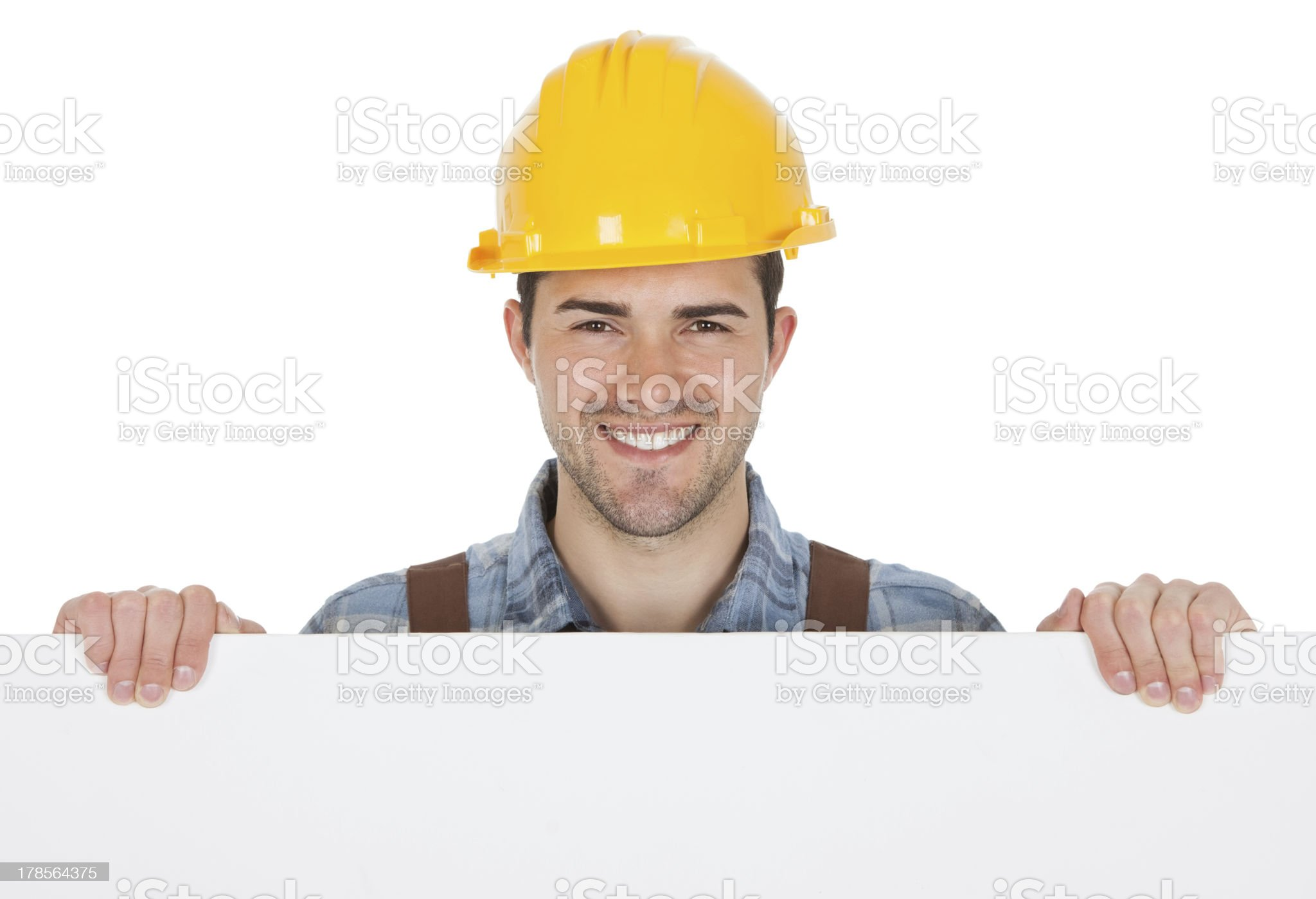 Worker wearing hard hat and holding empty banner royalty-free stock photo