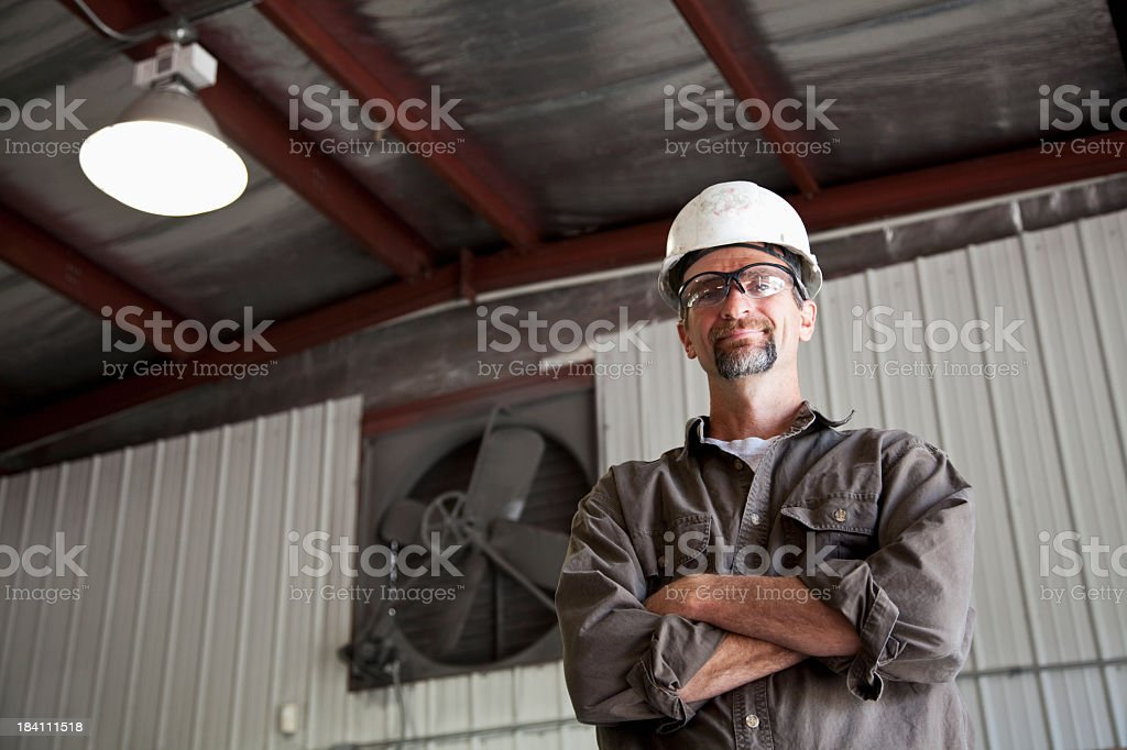 Worker wearing hard hat royalty-free stock photo