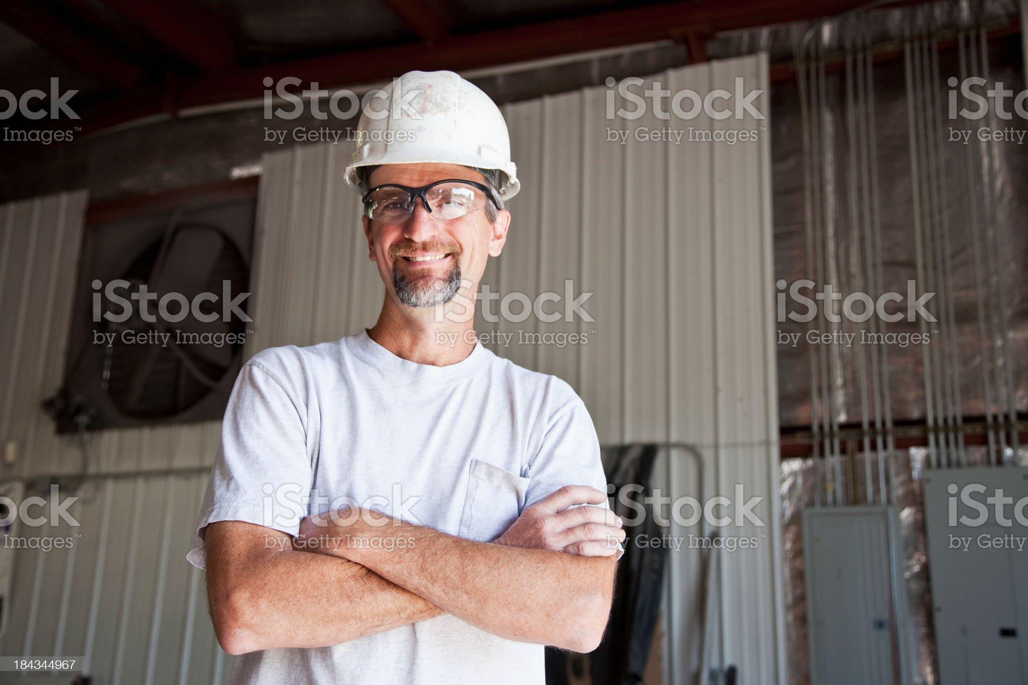 Worker wearing hard hat royalty-free stock photo