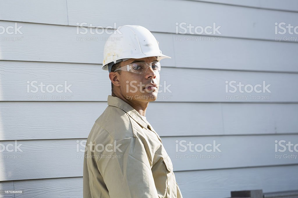 Worker wearing hardhat and safety glasses stock photo