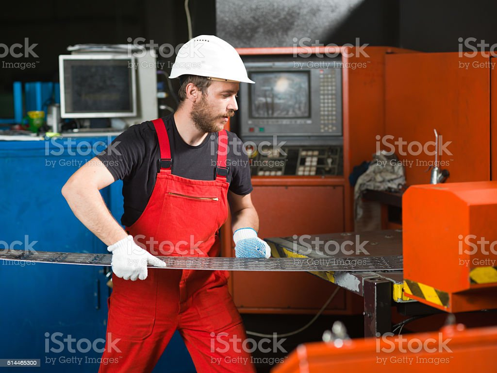 worker wearing red overalls stock photo