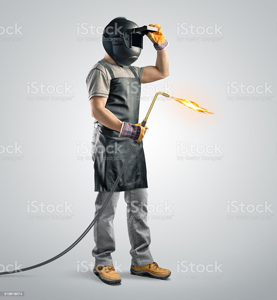 worker welder in a protective mask with gas welding machine stock photo