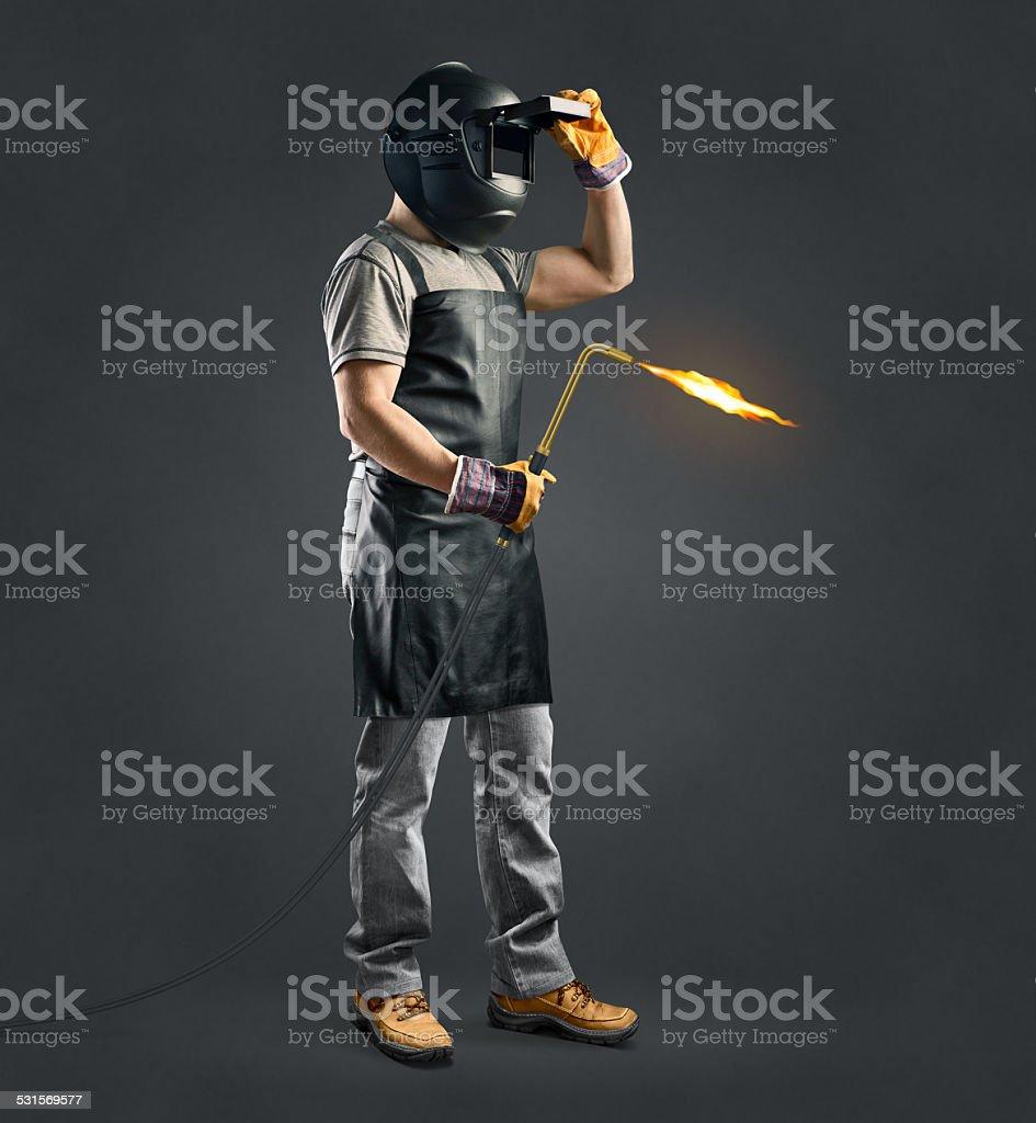 worker welder with gas welding machine stock photo