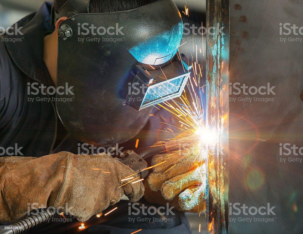 worker welding construction by MIG welding stock photo