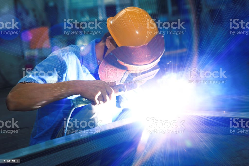 worker welding stock photo