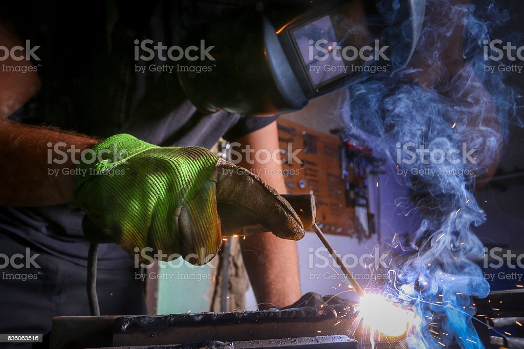 Worker welding the iron stock photo