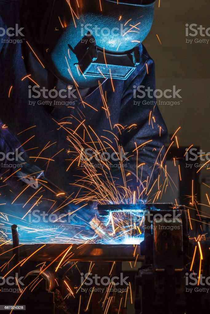 Worker welding the steel part by manua stock photo