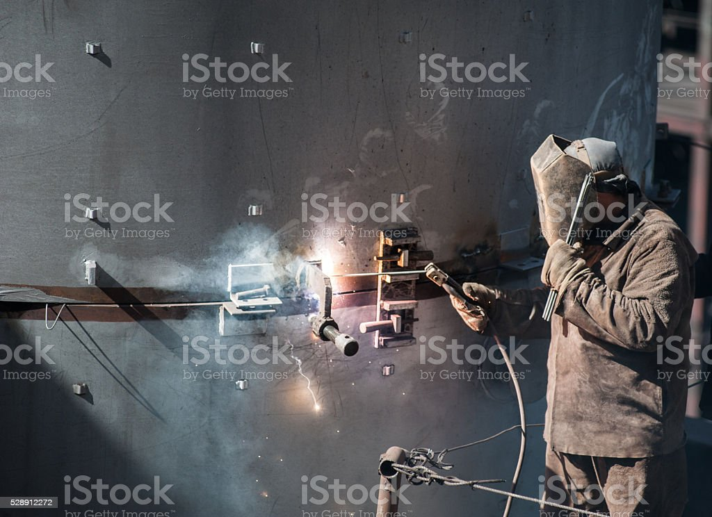 worker while doing a welding outdoor stock photo