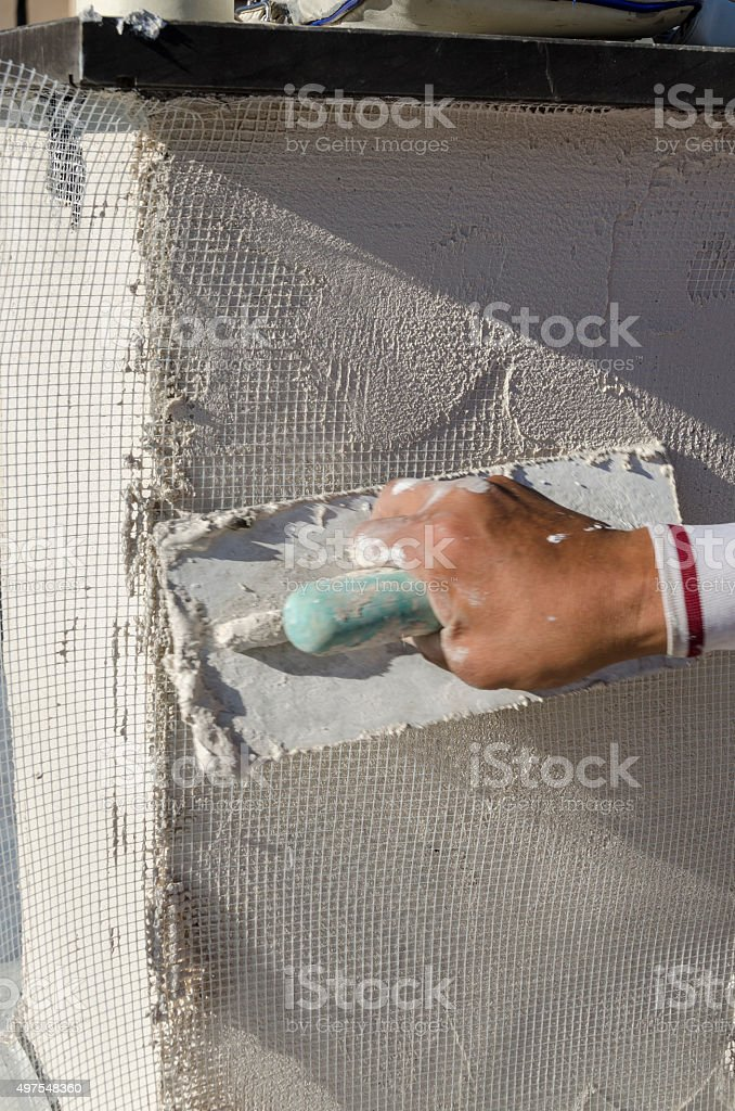 worker while shaving of a wall stock photo