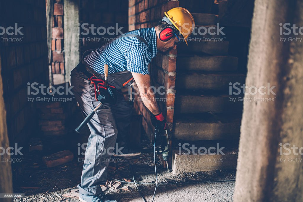 Worker with a drill stock photo