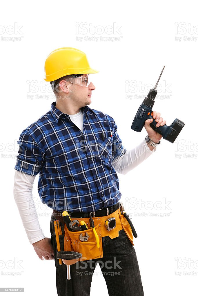 Worker with a hand drill royalty-free stock photo