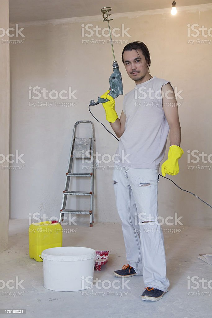 Worker with a power drill royalty-free stock photo
