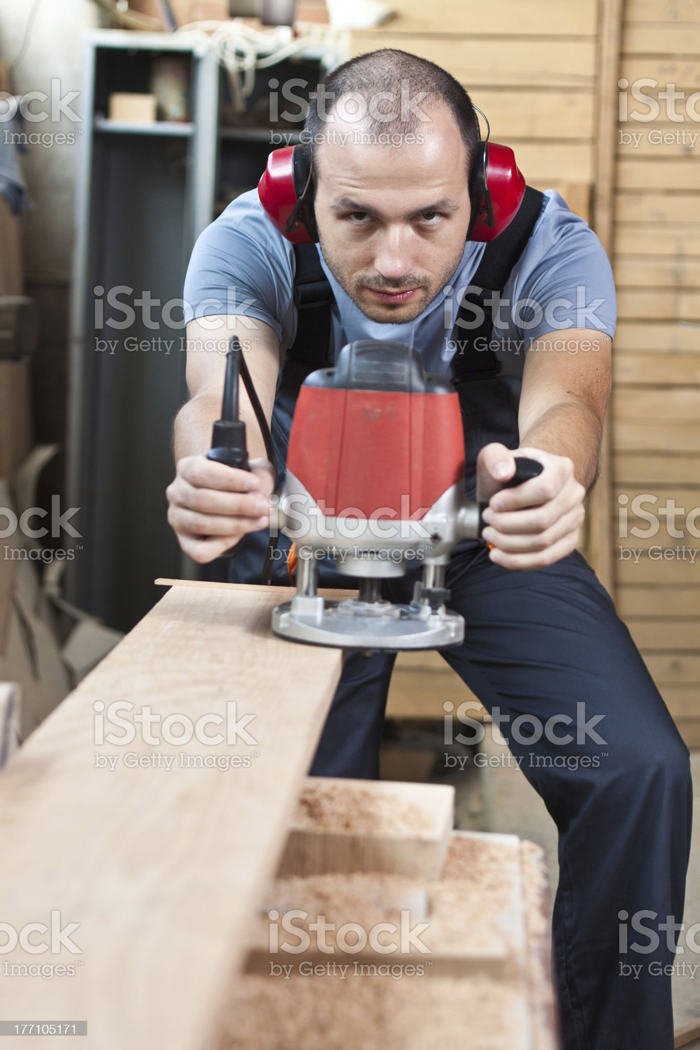 Worker with a router, vertical royalty-free stock photo