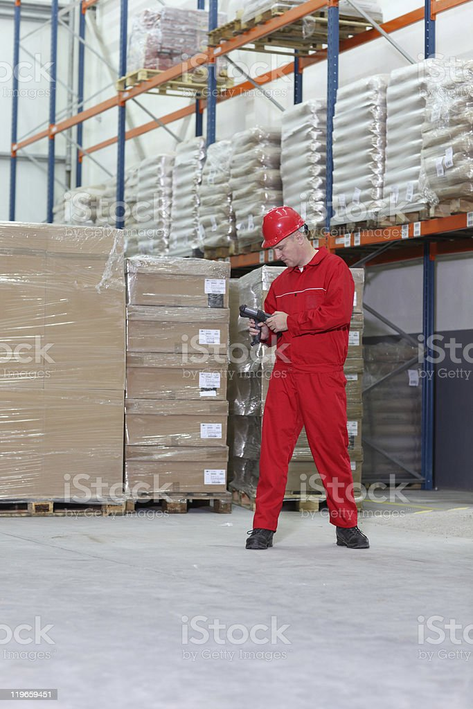 worker  with bar code reader preparing to work in warehouse royalty-free stock photo