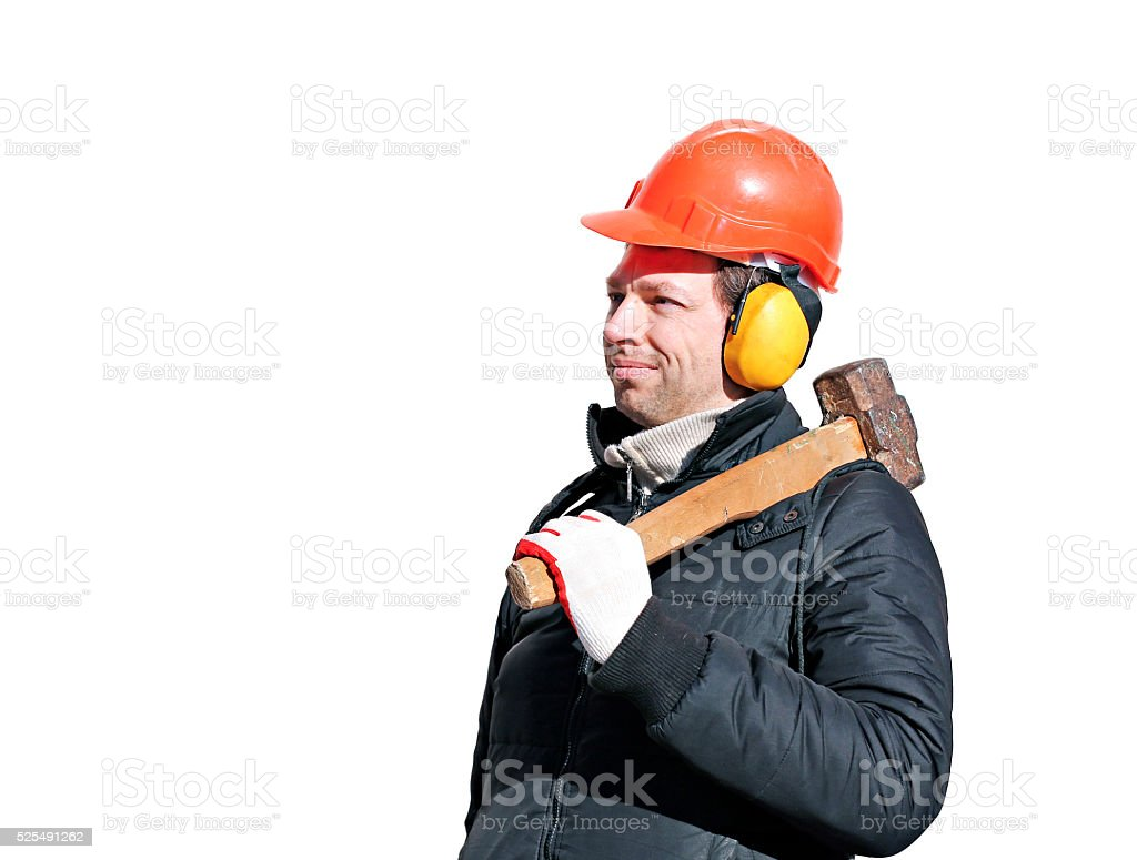 Worker with big sledge hammer on the shoulder stock photo