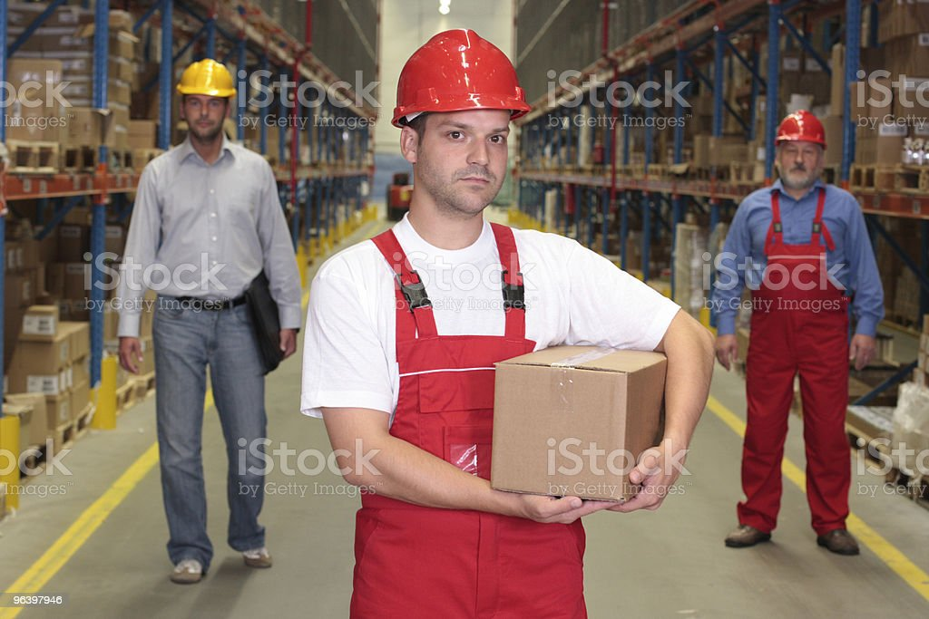 worker with box in warehouse royalty-free stock photo