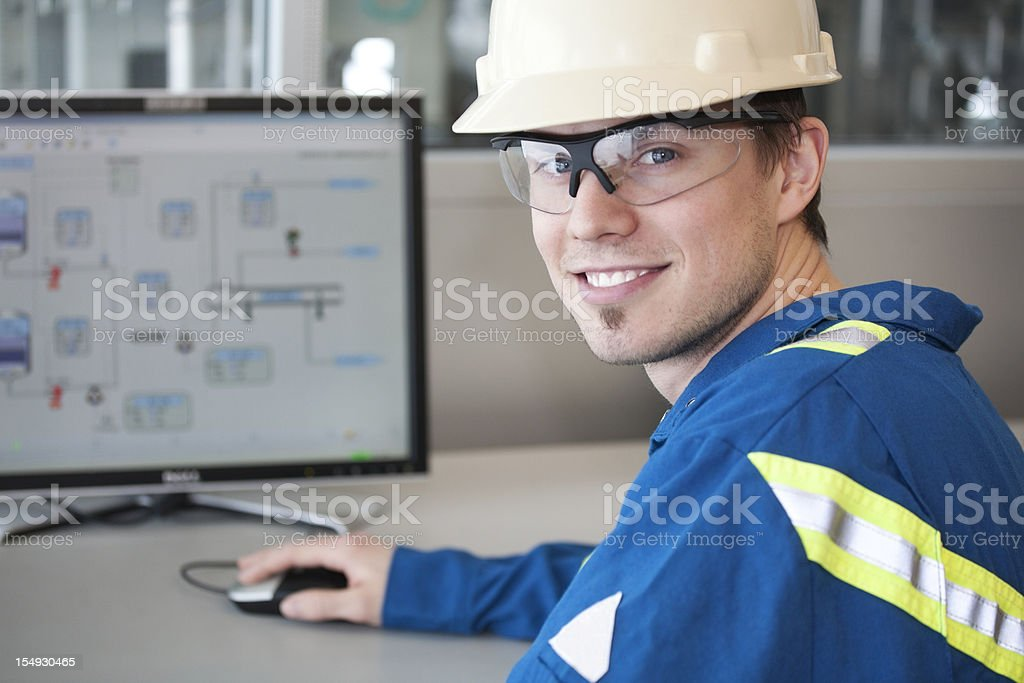 Worker  With Computer in Workplace stock photo