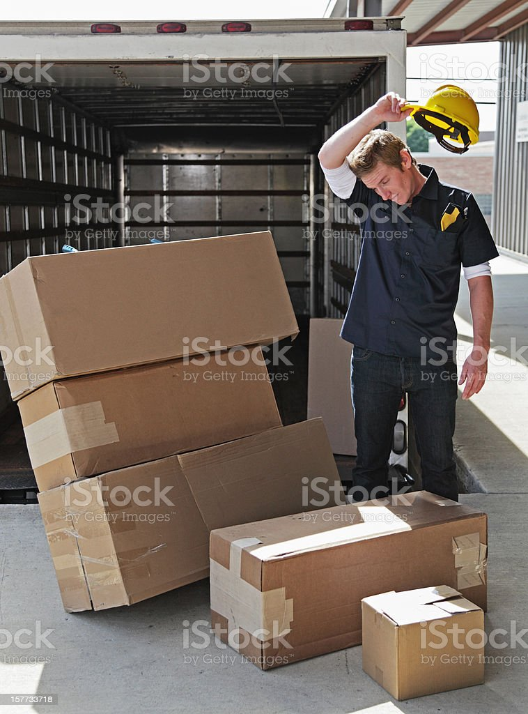 Worker With Damaged Boxes stock photo